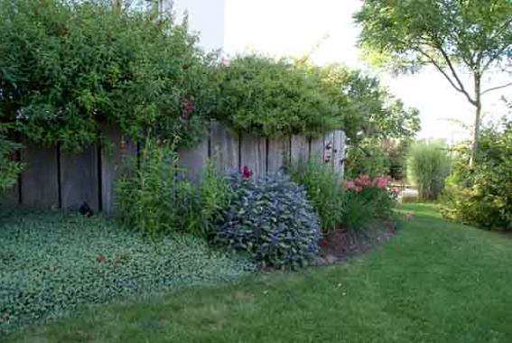 03 constructions en bois aubry paysage paysagiste for Entretien jardin 53